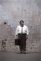 fat man full body - Man standing in warehouse Stock Photo - Premium Royalty-Freenull, Code: 6114-06598264
