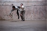 people falling - People fighting in warehouse Stock Photo - Premium Royalty-Freenull, Code: 6114-06598282
