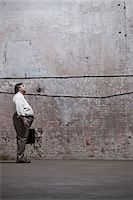 fat man full body - Man standing in warehouse Stock Photo - Premium Royalty-Freenull, Code: 6114-06598284