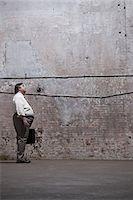 fat man full body - Man standing in warehou