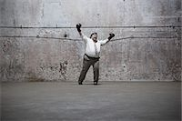 fat man full body - Man standing in warehouse Stock Photo - Premium Royalty-Freenull, Code: 6114-06598291