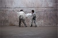 fat man full body - Two men having pillow fight in warehouse Stock Photo - Premium Royalty-Freenull, Code: 6114-06598294