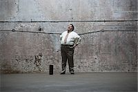 fat man full body - Man standing in warehouse Stock Photo - Premium Royalty-Freenull, Code: 6114-06598328