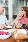 Happy couple at table outdoors Stock Photo - Premium Royalty-Free, Artist: Cultura RM, Code: 6114-06598460