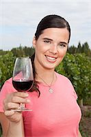 Woman in vineyard with red wine Stock Photo - Premium Royalty-Freenull, Code: 6114-06598541
