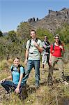 Hikers in rural landscape Stock Photo - Premium Royalty-Free, Artist: Westend61, Code: 6114-06598556