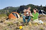 Couple camping in great outdoors Stock Photo - Premium Royalty-Free, Artist: Cultura RM, Code: 6114-06598565