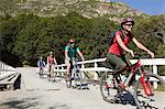 Four people cycling Stock Photo - Premium Royalty-Free, Artist: CulturaRM, Code: 6114-06598566
