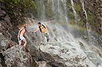 Couple on rocks by waterfall Stock Photo - Premium Royalty-Free, Artist: Robert Harding Images, Code: 6114-06598568