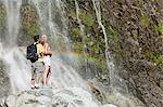 Couple by scenic waterfall Stock Photo - Premium Royalty-Free, Artist: I Dream Stock, Code: 6114-06598584