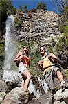 Couple standing near waterfall Stock Photo - Premium Royalty-Free, Artist: Cultura RM, Code: 6114-06598592