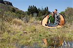 Couple camping in great outdoors Stock Photo - Premium Royalty-Free, Artist: Blend Images, Code: 6114-06598601
