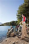 Couple by lake with mountain bikes Stock Photo - Premium Royalty-Free, Artist: Robert Harding Images, Code: 6114-06598604