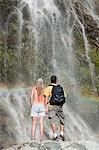 Couple by scenic waterfall Stock Photo - Premium Royalty-Free, Artist: Matthias Kulka, Code: 6114-06598607
