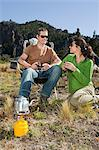 Couple camping in great outdoors Stock Photo - Premium Royalty-Free, Artist: AWL Images, Code: 6114-06598619