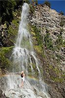 people in argentina - Woman standing by waterfall with arms open Stock Photo - Premium Royalty-Freenull, Code: 6114-06598627
