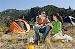 Couple camping in great outdoors Stock Photo - Premium Royalty-Free, Artist: ableimages, Code: 6114-06598628