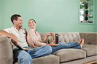 Young couple sitting on sofa Stock Photo - Premium Royalty-Freenull, Code: 6114-06598672
