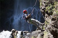 rock climber - Man abseiling by waterfall Stock Photo - Premium Royalty-Freenull, Code: 6114-06598694