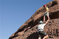 Two men rock climbing Stock Photo - Premium Royalty-Freenull, Code: 6114-06598706