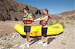 Couple putting on lifejackets for white water rafting Stock Photo - Premium Royalty-Free, Artist: Cultura RM, Code: 6114-06598710