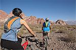 Man and woman mountain biking in rocky terrain Stock Photo - Premium Royalty-Free, Artist: CulturaRM, Code: 6114-06598722