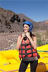 Woman ready for white water rafting Stock Photo - Premium Royalty-Free, Artist: Blend Images, Code: 6114-06598733