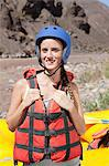 Woman ready for white water rafting Stock Photo - Premium Royalty-Free, Artist: Blend Images, Code: 6114-06598739