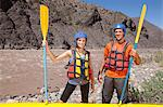 Man and woman ready for white water rafting Stock Photo - Premium Royalty-Free, Artist: Cultura RM, Code: 6114-06598755