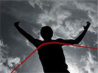 finish line - Silhouette of athlete at finish line Stock Photo - Premium Royalty-Freenull, Code: 6114-06598764