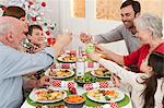 Family enjoying Christmas dinner Stock Photo - Premium Royalty-Free, Artist: Mitch Tobias, Code: 6114-06598817