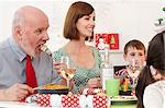 Family enjoying Christmas dinner Stock Photo - Premium Royalty-Free, Artist: CulturaRM, Code: 6114-06598822