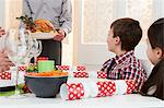 Family enjoying Christmas dinner Stock Photo - Premium Royalty-Free, Artist: CulturaRM, Code: 6114-06598842