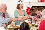 Family enjoying Christmas dinner Stock Photo - Premium Royalty-Free, Artist: Blend Images, Code: 6114-06598854