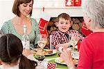 Family enjoying Christmas dinner Stock Photo - Premium Royalty-Free, Artist: CulturaRM, Code: 6114-06598863