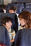 Mother and son on airplane Stock Photo - Premium Royalty-Free, Artist: Blend Images, Code: 6114-06599042