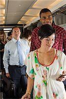 Passengers boarding a plane Stock Photo - Premium Royalty-Freenull, Code: 6114-06599098
