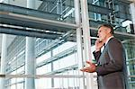 Businessman on cellphone in office Stock Photo - Premium Royalty-Free, Artist: Aflo Relax, Code: 6114-06599217