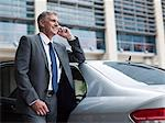 Businessman on cellphone by car Stock Photo - Premium Royalty-Free, Artist: Ikon Images, Code: 6114-06599221