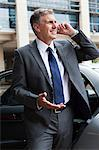Businessman on cellphone by car Stock Photo - Premium Royalty-Free, Artist: Uwe Umstätter, Code: 6114-06599230