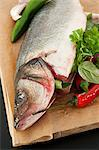 Raw fish on chopping board Stock Photo - Premium Royalty-Free, Artist: Cultura RM, Code: 6114-06599268