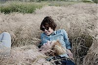 Young couple lying in grassy field Stock Photo - Premium Royalty-Freenull, Code: 6114-06599348
