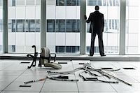Businessman in abandoned office Stock Photo - Premium Royalty-Freenull, Code: 6114-06599389