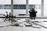 Despairing businessman in abandoned office Stock Photo - Premium Royalty-Freenull, Code: 6114-06599412