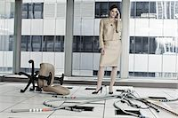 Businesswoman in abandoned office Stock Photo - Premium Royalty-Freenull, Code: 6114-06599417