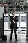 Businessman in abandoned office Stock Photo - Premium Royalty-Free, Artist: Michael Mahovlich, Code: 6114-06599443