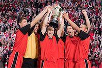 footballeur - Football team winning a trophy Stock Photo - Premium Royalty-Freenull, Code: 6114-06599634