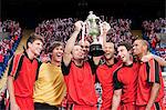 Football team winning a trophy Stock Photo - Premium Royalty-Free, Artist: ableimages, Code: 6114-06599636