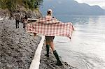 Young woman beside lake with checked shawl Stock Photo - Premium Royalty-Freenull, Code: 6114-06599723