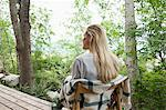 Young woman sitting on a porch Stock Photo - Premium Royalty-Free, Artist: Aflo Relax, Code: 6114-06599739